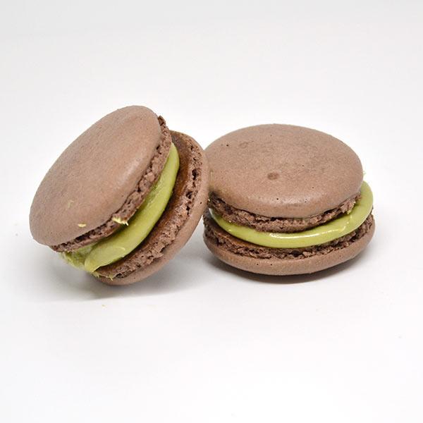 Chocolate macarons with pistachio cream